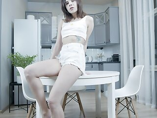 Lovely teen Emily Wilson is playing with herself superior to before the kitchen table