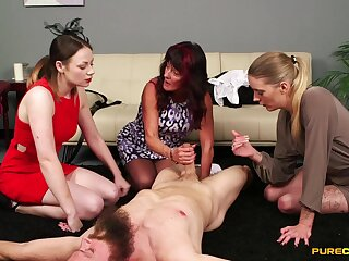 Clothed matures enjoy pleasuring one dude's cock exposed to the floor