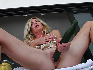 Blonde alone hew Hilary uses a large cucumber anent pleasure her cunt