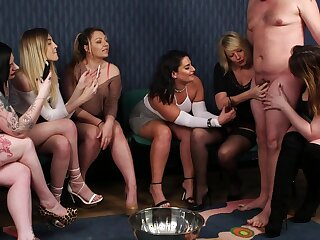 Group of clothed ladies take turns with a bloke's steadfast endowment
